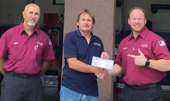 Borise Cota, National Sales Manager – Akebono Brakes Corporation (center) presents CAWA scholarship to Benjamin Hart (right), Pro-A-Line & Brakes technician, with John Dandash, Pro-A-Line owner observing.