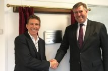 Sr, Graham Bready (right) congratulates EBS CEO Mark Luby on the opening of the firm's new facility