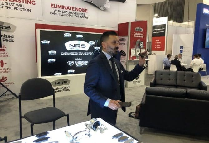 NRS Brakes CEO Montu Khokhar gives North American automotive journalists a chance to compare galvanized and non-galvanized brake pads at the company's press conference in Las Vegas.