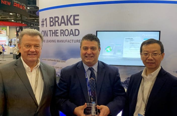 Doug Labac, VP Sales & Marketing, Winhere Brake Parts (left) and Jimmy Shum, President, Winhere Brake Parts (right) present Chick Capoli Jr, Chick Capoli Sales Company, with Winhere's first representative of the year award.