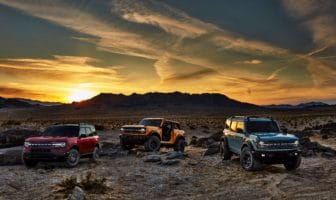 Pre-production versions of the all-new 2021 Bronco family of all-4x4 rugged SUVs, shown here, include Bronco Sport in Rapid Red Metallic Tinted Clearcoat, Bronco two-door in Cyber Orange Metallic Tri-Coat and Bronco four-door in Cactus Gray