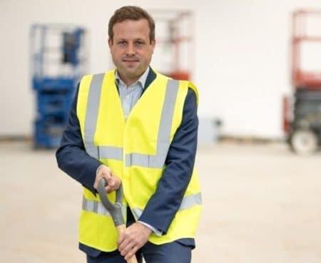 David Hamblin, AP Racing MD, helps break ground for the company's new NVH dynamometer
