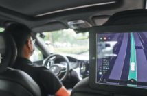 A driver participates in an autonomous driving road test in Shanghai