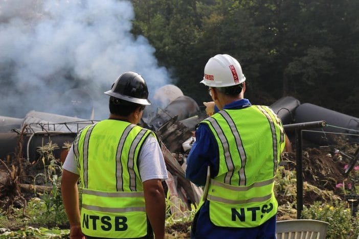 NTSB investigators Ruben Payan (left) and Paul Stancil survey the scene of the Aug. 2, 2017, Hyndman, Pennsylvania, train derailment in this photo taken Aug. 4, 2017